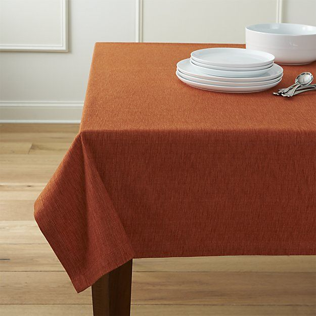 A classic staple for any kind of entertaining, this cotton-rayon tablecloth is woven of hand-dyed orange yarns, resulting in rich tone-on-tone color and variable texture.