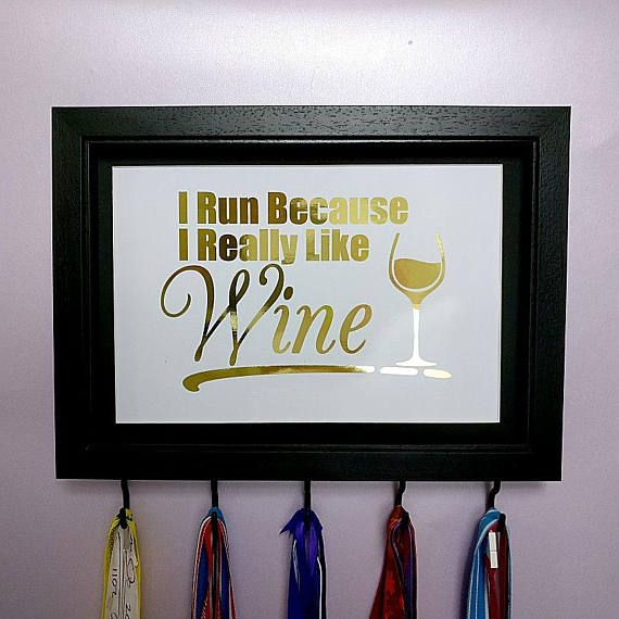 I Run Because I Really Like Wine Medal Hanger Frame Colour Options  Medal Hanger with 5 matching hooks.  These unique medal hangers are a great gift or treat for yourself. Have you got medals hanging on doors, hidden away in cupboards or stored in a box? Get them out and show them off!  These medal hanger frames are customisable so you can choose which colour frame you would like and your favourite foil colour.