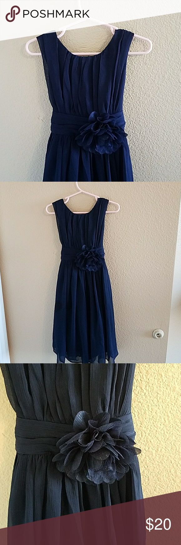 Bow Dreams Navy Blue Dress Size 4 Beautiful! Navy Blue Chiffon Dress with beautiful details. Big Slightly Glittery Flower at waist. Ties in back and Zips. Very Flowy,  my daughter loved spinning in it! Excellent Condition Bow Dreams Dresses