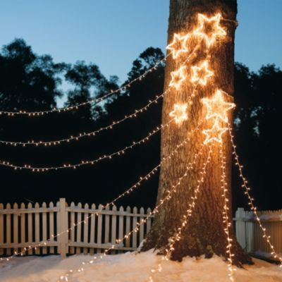 Shooting Star Cluster Light Displays - Create a spectacular nighttime scene with Grandin Road's Shooting Star Cluster Light Displays. Especially when festooned from tree to tree (or pole to pole) with a snowy backdrop, this cosmic array creates a striking display. #Frontgate  #HolidayDecor