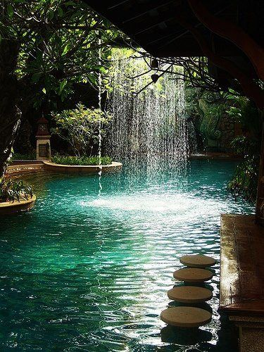Pool bar at Sawasdee Village Hotel, Phuket, Thailand. waterfall. barstools :)
