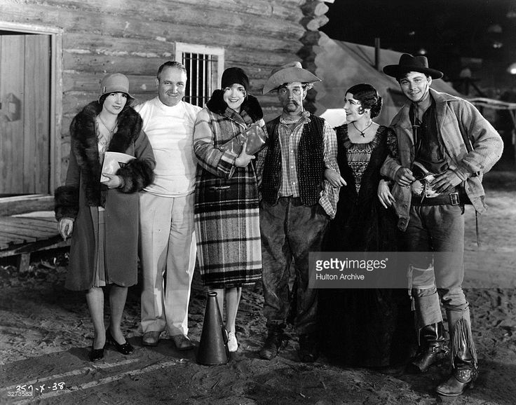 Cast and visitors on the set of 'The Tide Of Empire', directed by Allan Dwan. L-R: Natalie Talmadge Keaton, Allan Dwan, Constance Talmadge, Buster Keaton, who appeared in a cameo role, Renee Adoree, and William Collier Jnr.