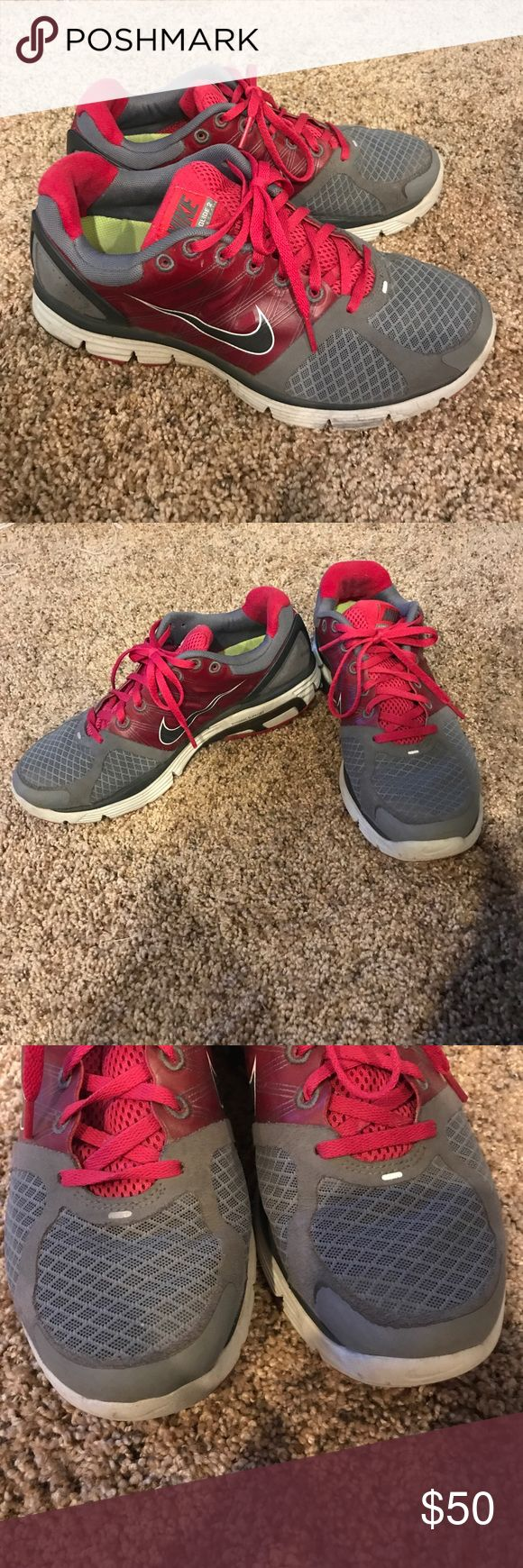 Gray and pink Nike tennis shoes Gray and pink Nike Lunarglide 2 tennis shoes. Gently worn (see pics). Nike Shoes Athletic Shoes