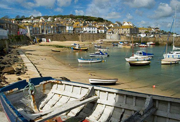 Google Image Result for http://www.travelsignposts.com/Devon_Cornwall/files/2009/06/mousehole-cornwall_588.jpg