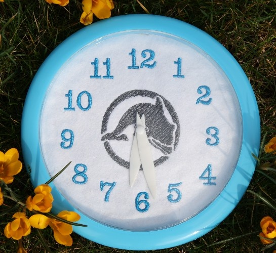 Clock with embroidered background on felt