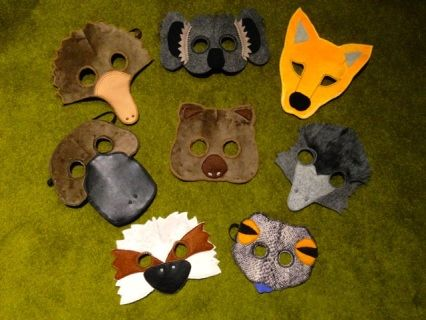 """""""Wombat Stew"""" mask set is based on the classic children's book - listen to the kids roar with laughter as the dingo is tricked .  This set is popular for kids parties &  pre-schools.  Includes; Total of 8 masks - Koala, Echidna, Platypus, Kookaburra, Blue tongue lizard, Emu, Dingo and Wombat. All designed and Handmade from soft and sturdy materials"""