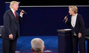 Republican U.S. presidential nominee Donald Trump and Democratic U.S. presidential nominee Hillary Clinton speak during their presidential town hall debate at Washington University in St. Louis, Missouri, U.S., October 9, 2016. REUTERS/Jim Young TPX IMAGES OF THE DAY