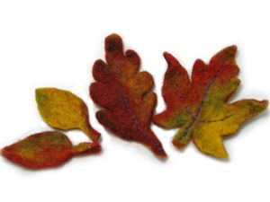 Wet felting fall leaves is a fun and adventurous process! You can mix colors in many different hues and create something vibrant and life-like. This little tutorial should get you started! Start with wool that will wet felt well in your chosen colors. I like a mixture of oranges, browns, greens,