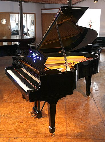 A 1926, Steinway Model O grand piano with a black case at Besbrode Pianos. 10 year warranty