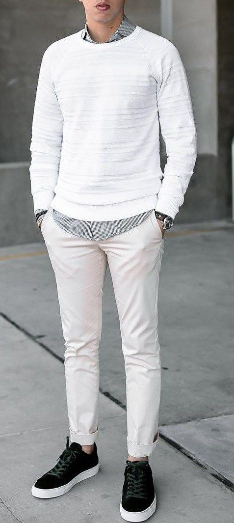 White Sweat Shirt Layered Over Grey shirt & both Paired With Off white Chinos