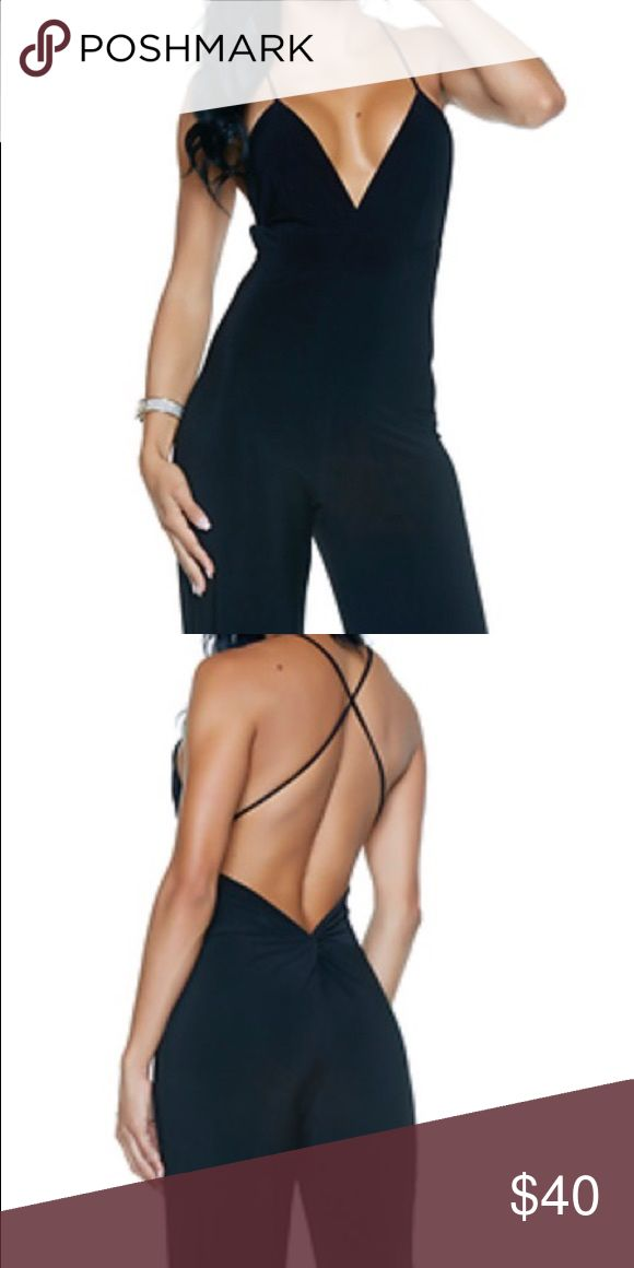 Wide Leg Sexy Jumpsuit Wide Leg Jumpsuit  * Crisscross Back Straps *Knot Detail * Made in the USA  92% Polyester  8% Spandex   Not a resold item from popular Asian websites. Quality item.   Size: Medium  Color: Black   Fits: Bust 34-36, Waist 26-28, Hips 36-38, Dress 4-6.  Fast Shipping  Price Is FIRM   Lower price comments will be ignored  Thank you for viewing my listing, new items added weekly. Other