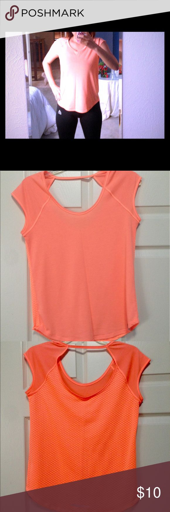 Orange Workout shirt Orange Under Armour workout shirt. It is sleeveless and smooth textured in the front and ribbed in the back with a string that goes across the back. Worn a few times, it is a small but I cut the tag out because it kept poking me in the back. Under Armour Tops Tank Tops