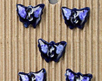 Butterfly buttons. Handmade fully washable. Use to replace plastic or adorn a pocket, hat, sleeve, bag, apron, cushion cover. Use in paper craft from scrapbooking to making gift tags and greeting cards...