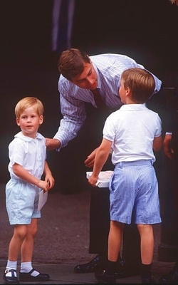 Prince Andrew, Duke of York greets his nephews Princes William and Harry with a kiss when they arrive at a hospital following the birth of Princess Beatrice August 11, 1988.