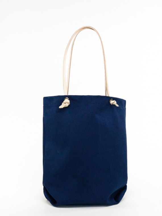 Simple and minimal traditional reusable shopping tote. The perfect gift for every eco conscious person - the ultimate stylish canvas shopper. Genuine leather handles - adjustable to your liking ! Simply practical, practically beautiful.   Comes in three colors of canvas and in a luxurious leather version - The Radana bag : Ask me for a customization! Natural Canvas  Cinnamon Canvas  Navy Blue Canvas  Dimensions:   Height: ~ 16  Width: ~ 13.5  Depth: ~ 3.5  Handle drop: ~ 9.75 - customizable…