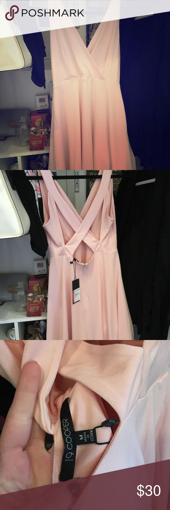 Ballet Pink Mini Dress Pink mini dress, new tags still attached. Waist sits slightly above natural waist, deep v neckline, cross cross back, full skirt, dress is lined. The fabric is super soft and so is the lining, I love it I just have no where to wear it. 95% polyester, 5% spandex. 19 Cooper Dresses Mini