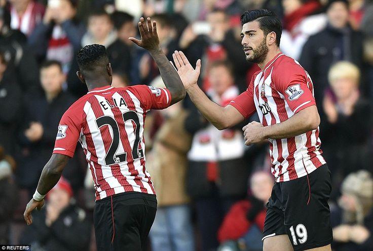 Eljero Elia (left) high-fives goalscorer Pelle after he headed in from a James Ward-Prowse...