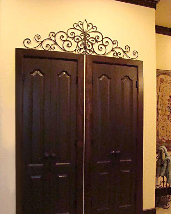 iron wall art above door