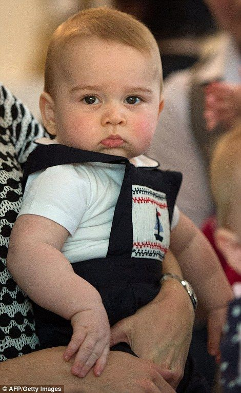 The little Prince, on first tour to New Lane in the care of his parents. George's mom has dressed Prince George in similar smock type outfit that Prince William wore upon his arrival in New Zealand.