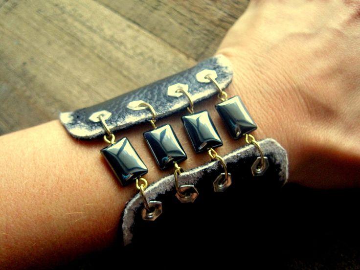Gothic Beautiful Black Distressed and Hematite Cuff Handmade Leather Jewelry Steampunk. $52.00, via Etsy.
