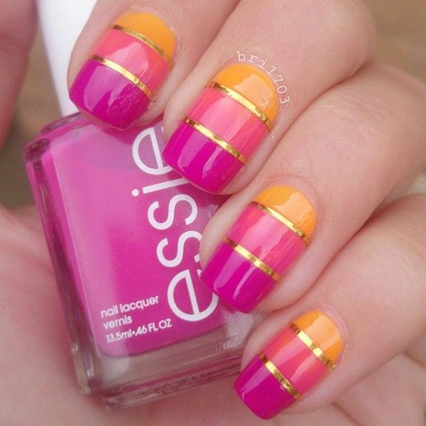 A tricolor metallic nail art design using shades of fuchsia, carnation pink and yellow orange; topped with strips of metallic gold.