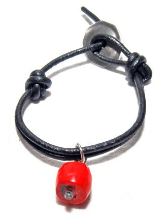 A simple red bead adds a splash of colour to a trendy Tumeka Wrist Button.
