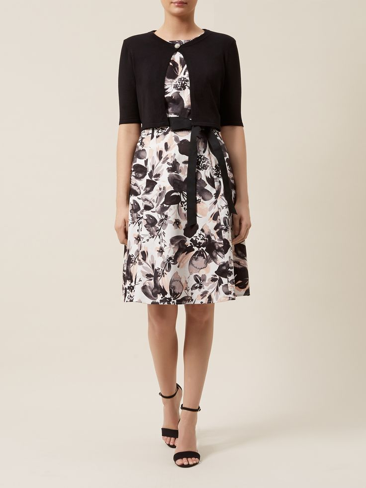 Kaliko combination of black shrug €65 and floral prom dress with black and white print €169.