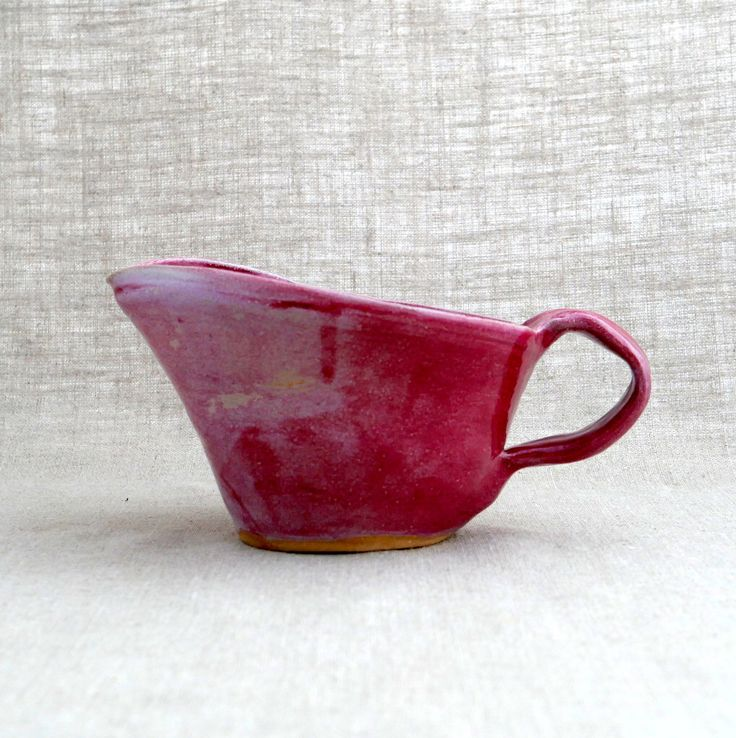 Vintage Pottery Gravy Boat in Pink / Hand Thrown Pottery / Ceramic Gravy Boat / Sauce Dish by HouseUpon on Etsy https://www.etsy.com/listing/254564218/vintage-pottery-gravy-boat-in-pink-hand