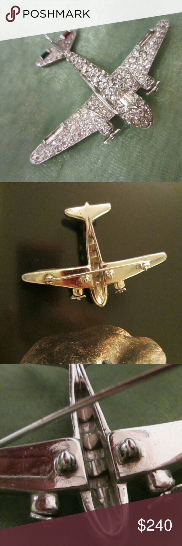 """Trifari silver tone airplane swarovski brooch Trifari silver tone airplane brooch embellished with white  shiny swarovski crystals and a few colored stones. Red and green baguettes.  Excellent condition.  In tact and fab. Probably from post 1940's. About 2"""". It is marked in etch. Propeller moves. This piece is unique not ordinary. Trifari Jewelry Brooches"""