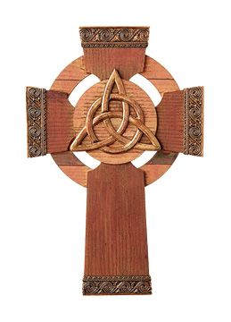 """Trinity Knot Celtic Cross Small churches dot the Irish countryside; local families worshipping in the same pews for generations. The solace and comfort of faith and tradition found in these humble churches inspires this wood-grained Celtic cross. The distinctive Celtic circle features a trinity knot in the center, embodying the everlasting mysteries of the divine. 9"""" x 6""""; resin. $25.00"""