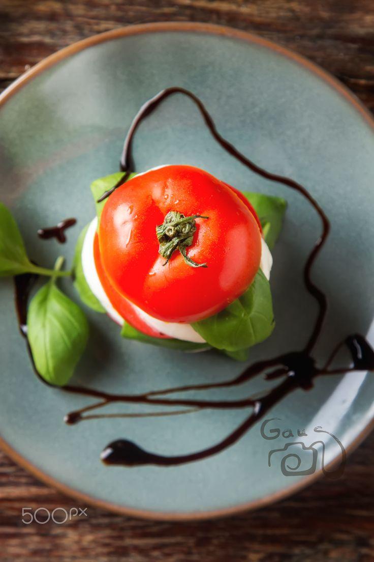 Fresh italian Caprese salad tomato and mozzarella slices with ba - Fresh italian…