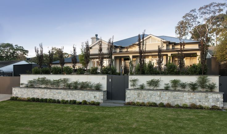 Landscaping really finishes a home to perfection - and multi layered landscaping adds interest