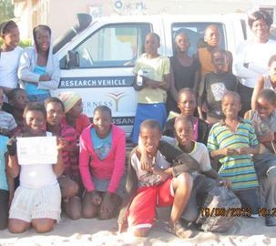Children with the CITW vehicle at Gumare Primary School