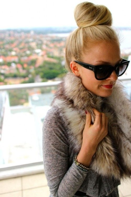 Everything from her top knot to that faux fur scarf!
