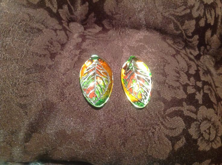 Earrings, made from silver plate teaspoon bowls, flattened, coloured with alcohol ink and enhanced with metal leaf beads.