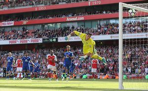 Everton goalkeeper Joel Robles is beaten by Aaron Ramsey's brilliant injury-time strike from 20 yards for the Gunners third.