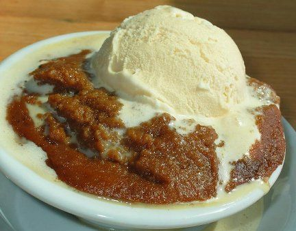 Indian or Hasty Pudding....a sweetened, spiced, warm corn meal pudding, served with vanilla ice cream....of English origin..then, Americanized.     This recipe has been corrupted..there are NO dates or Raisins in it.  See original recipe.