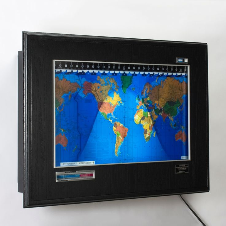 The Geochron allows any observer to determine what time it is anywhere in the world. The colorful map is an endless belt that is driven slowly from left to right by an electric clock motor in synch with the rotation of the earth. Time zone boundaries are delineated on the map by dark blue lines which converge on lettered pointers on the top edge of the map. These letters identify the standard time zones and also represent the short wave radio prefix for that zone.