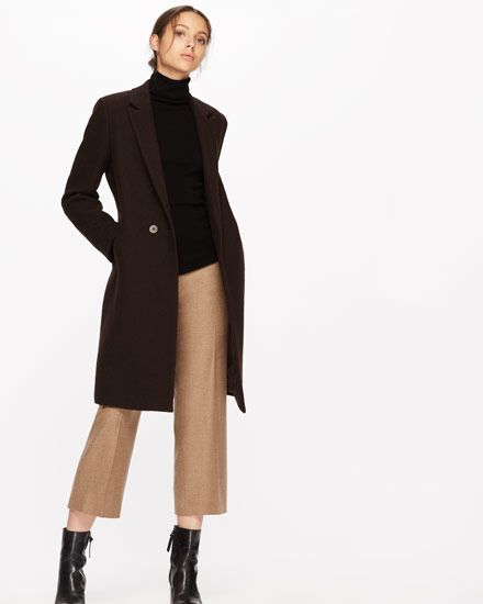 Known for her monumental abstract sculptures of steel and other metallic materials, Brigitte Matschinsky-Denninghoff has inspired the golden moss tone of this slim, sable wool coat. Double breasted, features include corozo buttons, full lining, notch lapels and a single back vent for a smart finish. Layer this luxury design over your working wardrobe of casual pieces for a contemporary edge.