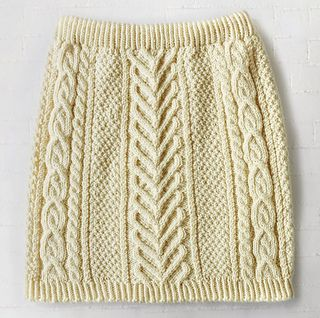 Step up your fall wardrobe with this stylish cable knit skirt. (Yarnspirations)