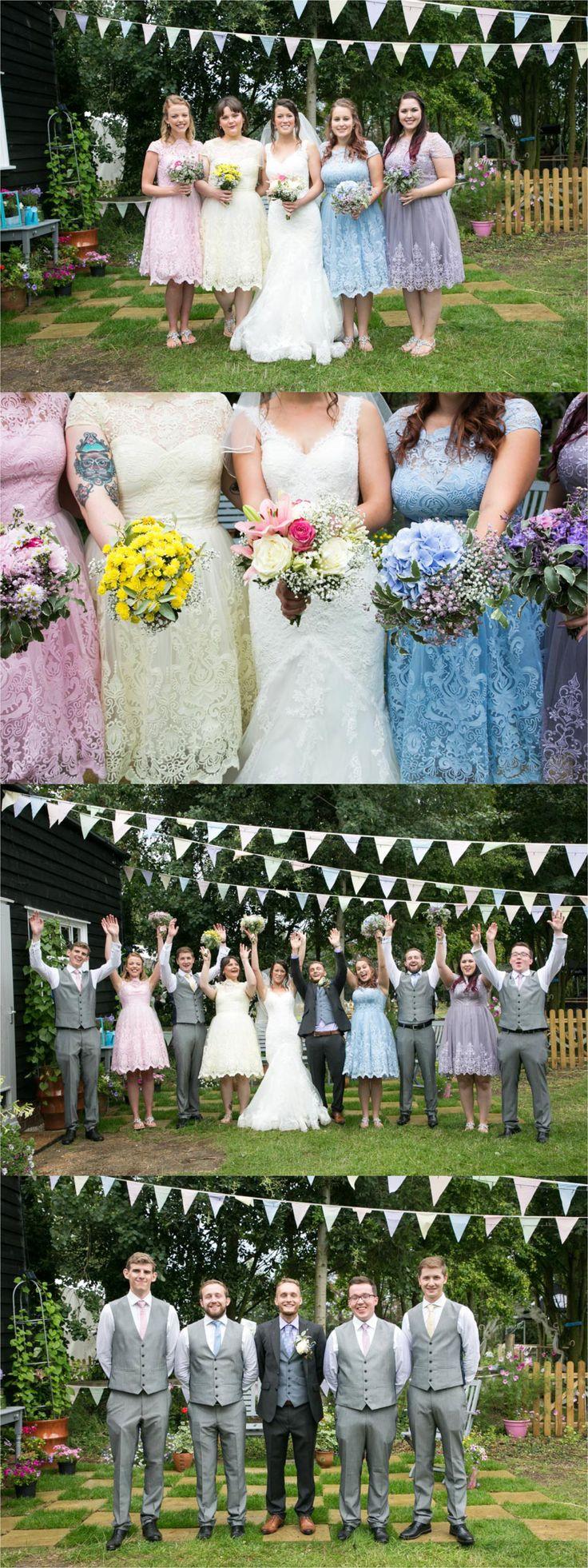 multicoloured pastel bridesmaids at suffolk farm wedding