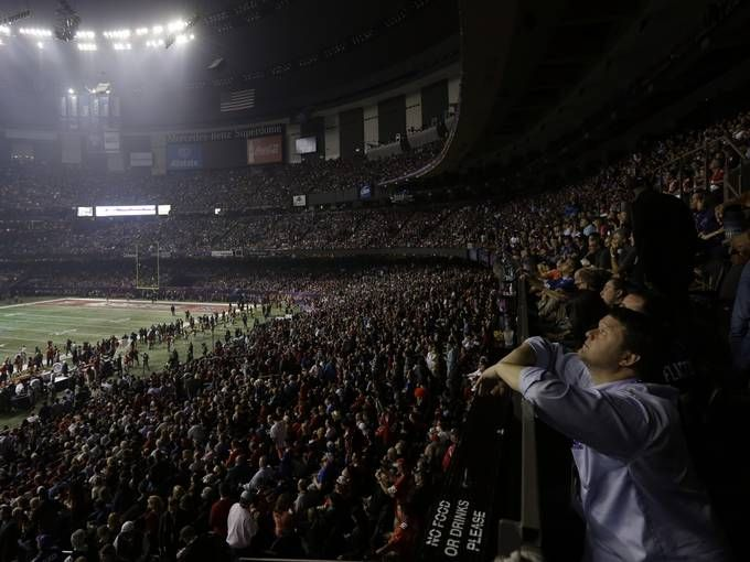 A fan looks around the Superdome after the lights went out during the second half of Super Bowl XLVII.  Gerald Herbert, AP. Monday post 6pm
