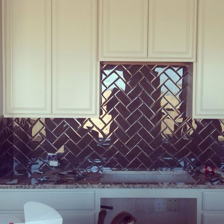 Glass Subway Tile Backsplash In Herringbone Pattern