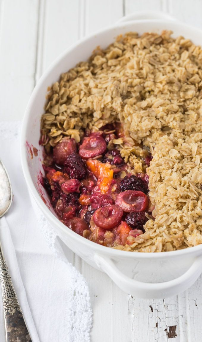Gluten Free Fruit Crisp is a perfect way to combine seasonal fruits for a really delicious baked dessert that is low enough in sugar per serving it also doubles as a healthy breakfast. You can serve it hot or cold, with ice cream, whipped cream, or simply enjoy it on it's own with nothing in addition. This recipe is Vegan.