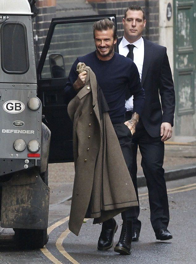David Beckham Spotted With Kent & Curwen Coat And Dr. Martens Boots