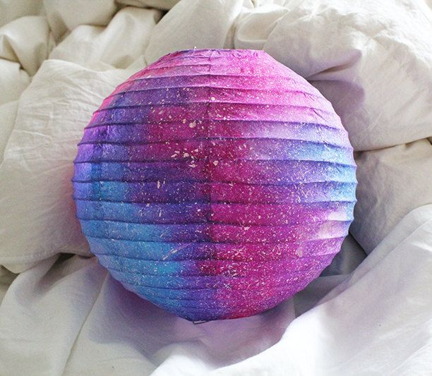 Galaxy Paper Lantern.That would be a simple(not easy) DIY all you need is colours and a white lattern