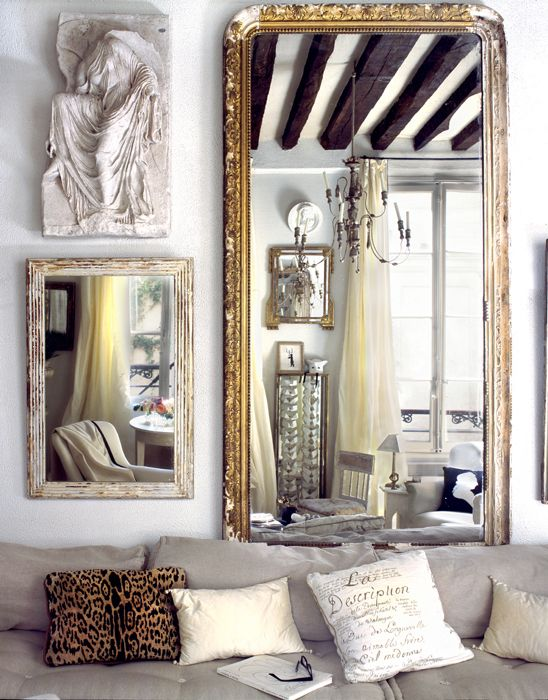 beautiful antique gold mirror in a modern living room