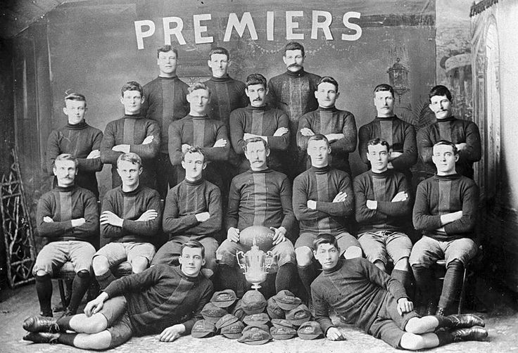 Warracknabeal Football Team, premiers in 1909. The premiership cup is in front of the group surrounded by the team members ' caps.