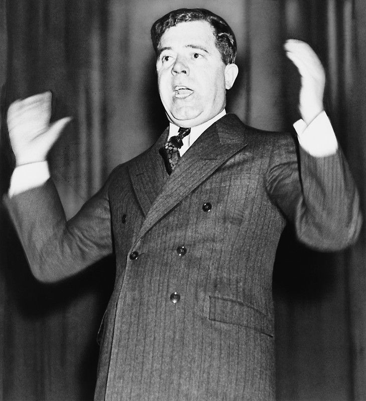Huey P. Long - The Kingfish - This vintage photo features Louisiana Senator Huey P. Long at a speaking engagement. Photo taken circa 1934. Celebrate American History with this digitally restored vintage poster from The War Is Hell Store.