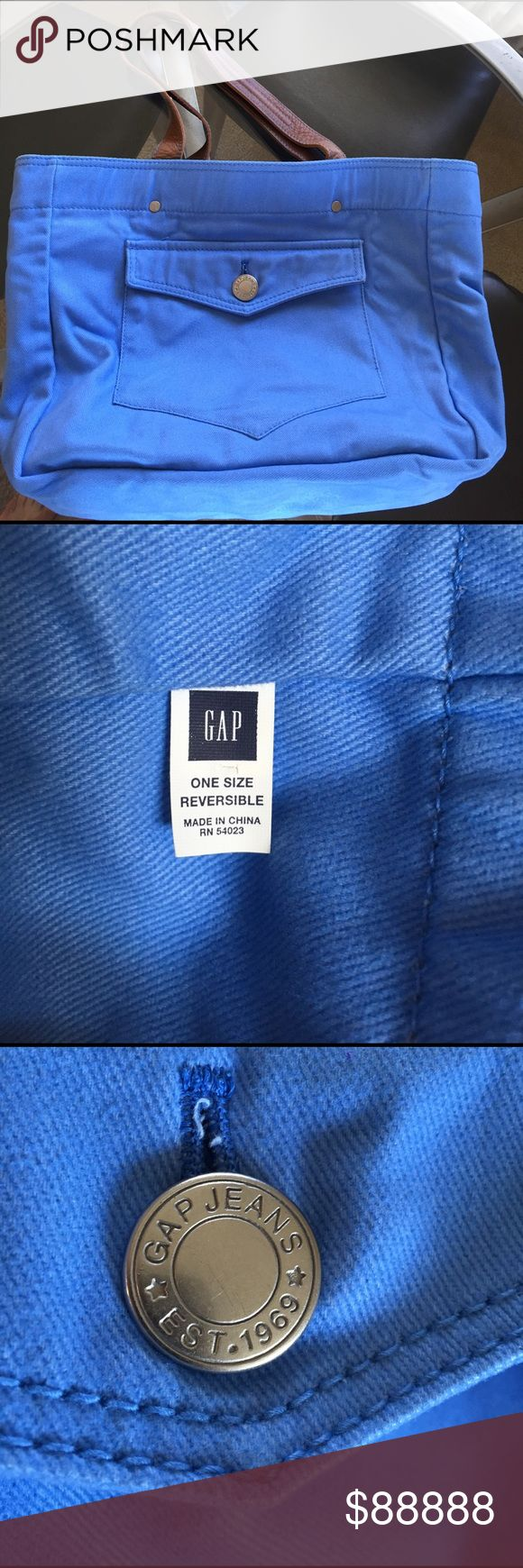 EUC Reversible GAP Tote: Leather & Cotton This EUC GAP Tote Bag is made of heavy weight baby-soft cotton. Reversible from a gorgeous solid blue to multi blue stripes.  Solid blue side features a functional one button pocket. The striped side does not have a pocket.  Leather straps with beautiful blue stitching.   Used once & stored.   The striped side has a small, very faint area of discoloration near the handle. See last photo. Priced accordingly. GAP Bags Totes
